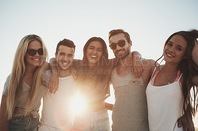 Buy stock photo Shot of a group of friends having fun on the beach