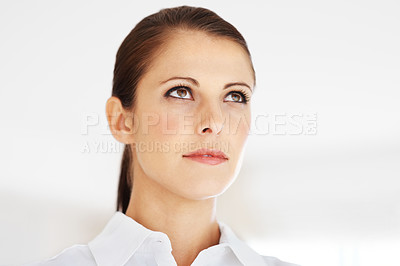 Buy stock photo Closeup portrait of a cute young woman looking away at something interesting