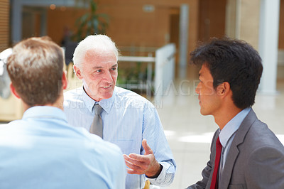 Buy stock photo Cropped shot of businessmen having a discussion