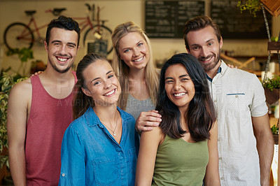 Buy stock photo Portrait of a group of friends hanging out at their favourite cafe