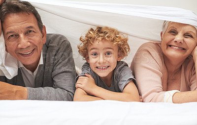 Buy stock photo A young boy having fun with his grandparents