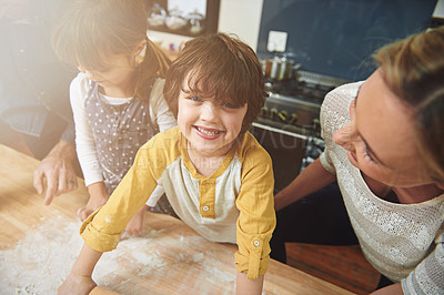 Buy stock photo Cropped shot of a family enjoying pizza at home