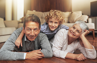 Buy stock photo Shot of an elderly couple spending time with their grandson at home