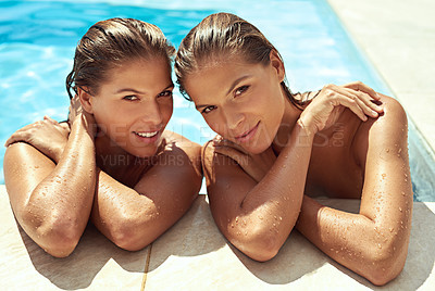 Buy stock photo Portrait of twins relaxing in a swimming pool