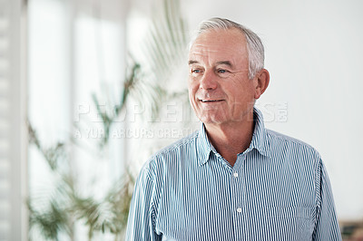 Buy stock photo Shot of a senior man looking thoughtful at home