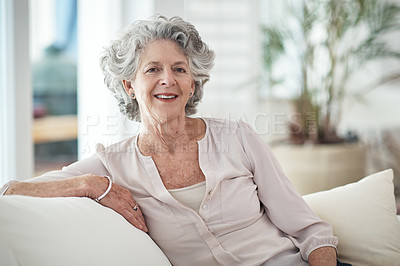 Buy stock photo Portrait of a senior woman sitting on the sofa at home