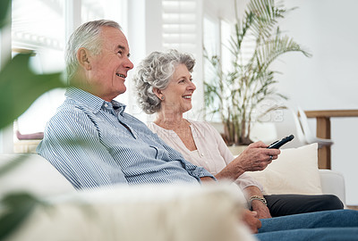 Buy stock photo Cropped shot of a senior couple watching television at home