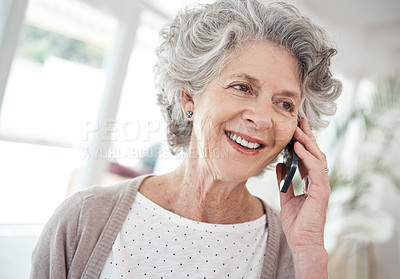 Buy stock photo Cropped shot of a senior woman talking on her cellphone at home