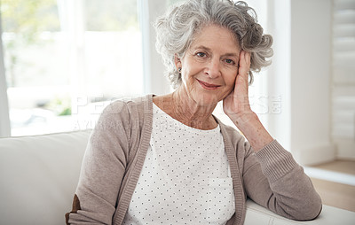 Buy stock photo Cropped portrait of a senior woman relaxing on the sofa at home