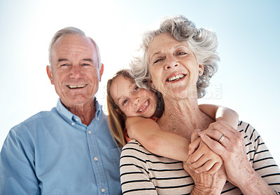 Buy stock photo Shot of grandparents with their granddaughter in the outdoors