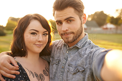 Buy stock photo Shot of an affectionate young couple taking a selfie together