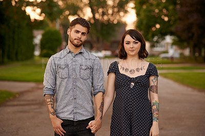 Buy stock photo Portrait of a young couple holding hands outdoors