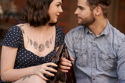 Buy stock photo Shot of a young couple enjoying  some drinks together