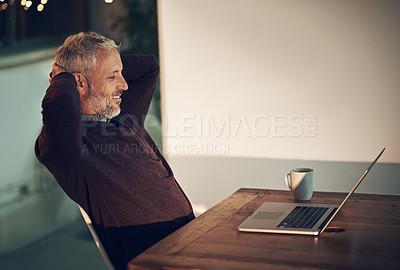 Buy stock photo Cropped shot of a mature businessman working late at the office