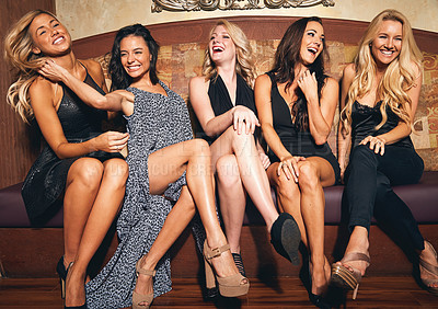 Buy stock photo Shot of a group of young women sitting on a sofa in a nightclub