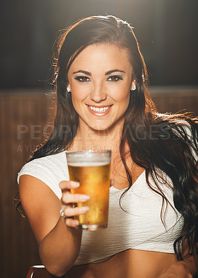 Buy stock photo Shot of a young woman showing you a beer in a nightclub