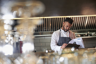 Buy stock photo Cropped shot of a chef working in the kitchen