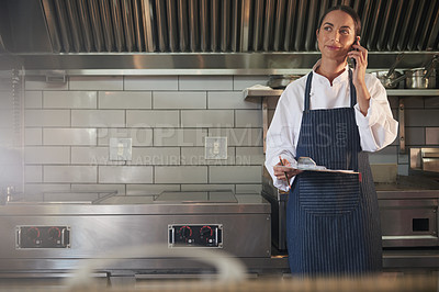 Buy stock photo Shot of a chef talking on a cellphone in a kitchen