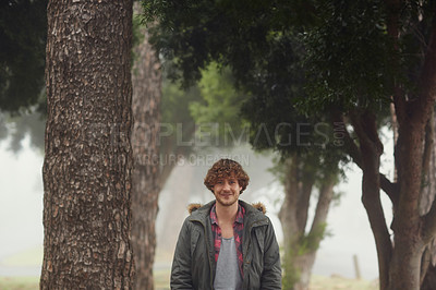 Buy stock photo Cropped portrait of a young man outdoors