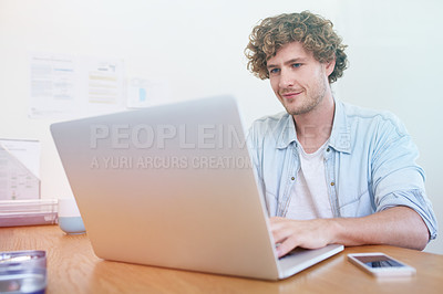 Buy stock photo Shot of a young designer at work in his home office