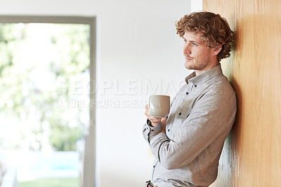 Buy stock photo Cropped shot of a young businessman looking thoughtful while drinking coffee at home