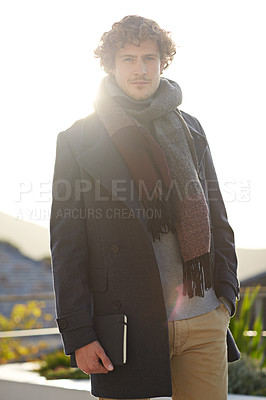 Buy stock photo Cropped portrait of a young man carrying his diary outdoors