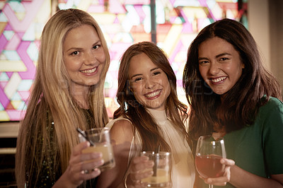 Buy stock photo Shot of three girlfriends enjoying a night out at a club