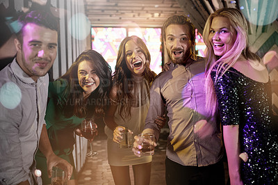 Buy stock photo Shot of a group of friends having an awesome time while out partying