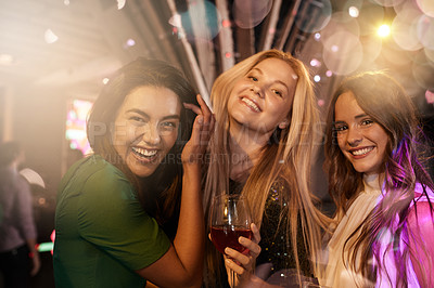 Buy stock photo Portrait of three girlfriends enjoying a night out at a club