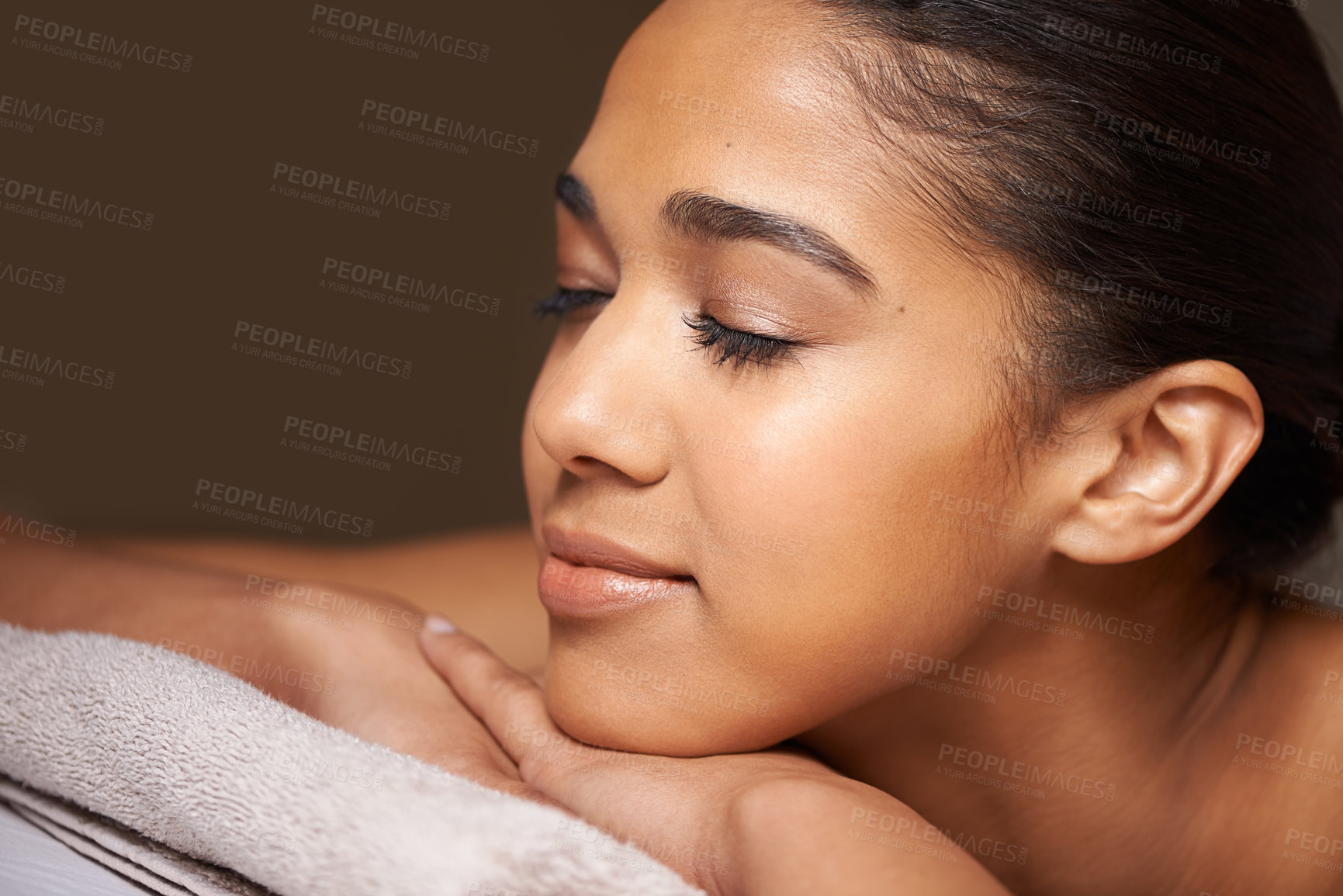 Buy stock photo Cropped shot of a beautiful young woman relaxing during a spa treatment
