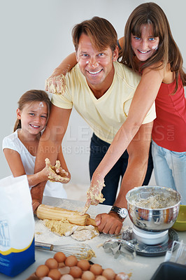 Buy stock photo Portrait of family kneading dough using rolling pin in the kitchen