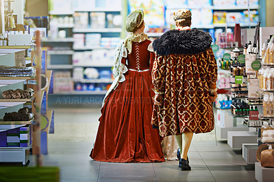 Buy stock photo Rearview shot of a king and queen looking at goods while shopping in a modern grocery store
