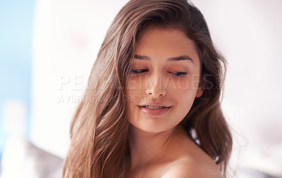 Buy stock photo Shot of a beautiful young woman indoors