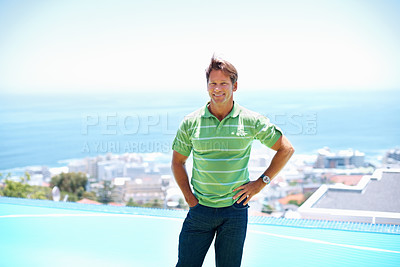 Buy stock photo Portrait of smart man standing with hand in pocket and smiling