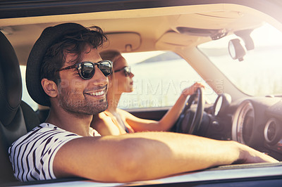 Buy stock photo Shot of a young couple on a roadtrip