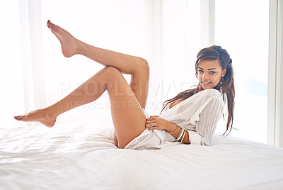 Buy stock photo Portrait of a gorgeous young woman posing seductively on her bed