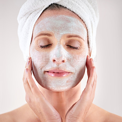 Buy stock photo Cropped shot of a mature woman with a mask applied to her face