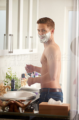 Buy stock photo Cropped portrait of a man shaving in his bathroom