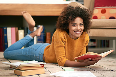 Buy stock photo Full length portrait of a young woman lying on the floor while studying