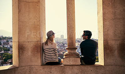 Buy stock photo Shot of a young couple working through a foreign city
