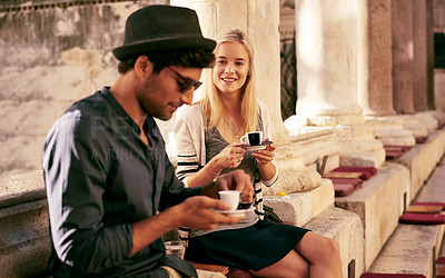 Buy stock photo Shot of a young couple taking a coffee break while touring a foreign city