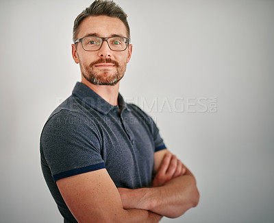 Buy stock photo Cropped portrait of a mature man standing against a gray background