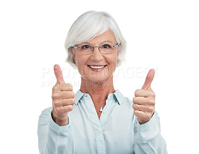 Buy stock photo Studio shot of a senior woman giving you thumbs up against a white background