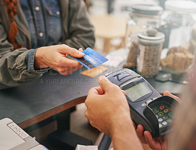 Buy stock photo Cropped shot of a customer paying by credit card in a coffee shop