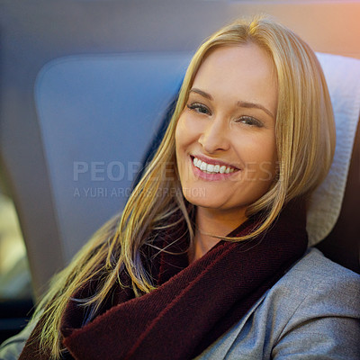 Buy stock photo Portrait of a young woman sitting in first class on an airplane