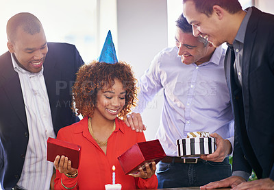 Buy stock photo Cropped shot of a group of coworkers celebrating a birthday