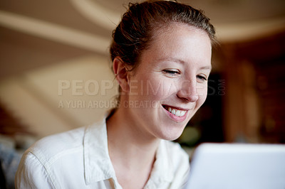 Buy stock photo Cropped shot of a young woman using her laptop at home