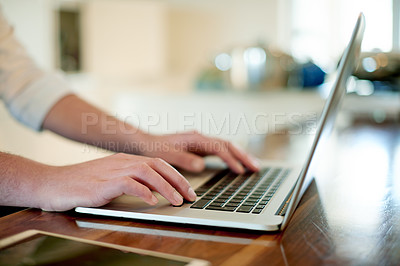 Buy stock photo Closeup shot of a man working on a laptop at home