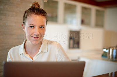 Buy stock photo Portrait of a young woman working on a laptop at home