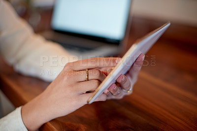 Buy stock photo Closeup shot of a woman using a digital tablet at homeeople working at home